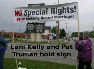 Kelly Truman Holding Sign 1